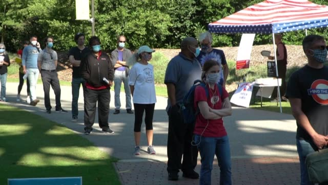 long lines are forming outside the polling station at north carolina state university as north carolinians participate in early voting ahead of... - north carolina us state stock videos & royalty-free footage