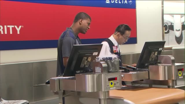 ktla long lines at delta air lines checkin counter at lax - delta air lines stock-videos und b-roll-filmmaterial
