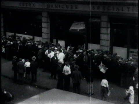 long lines of people before building with sign reading the salvation army / united states - 1932 stock videos & royalty-free footage