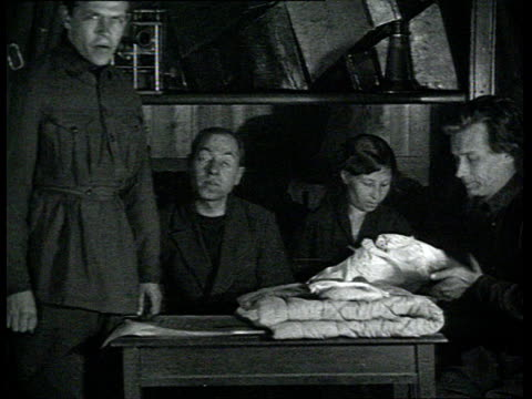 Long live the Soviet Republic Avantgarde movie about labor and NEP everyday life At work woman with newborn baby ceremony of communist baptism is...