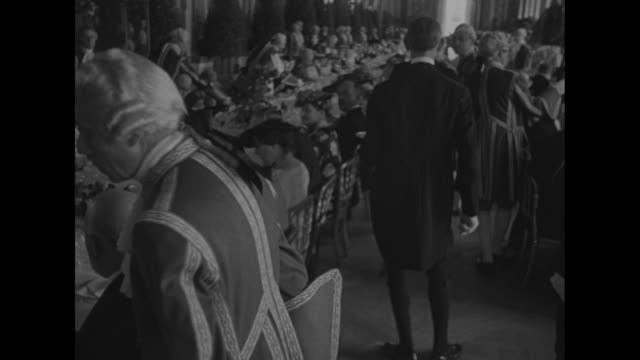 ls long luncheon tables with guests in the hall of mirrors at the palace of versailles king george vi and queen elizabeth are guests at this luncheon... - king royal person stock videos & royalty-free footage