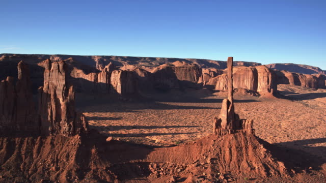 long morning shadows of totem pole and yei bi chei, monument valley - drone shot - navajo culture stock videos & royalty-free footage