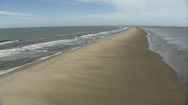 aerial long, narrow, smooth sandbar with sea on one side and bay on other / camargue, bouches-du-rhone, france - seascape stock videos & royalty-free footage