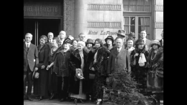 long pan members of the democratic national committee pose in group shot outside the hotel lafayette / men in group smile chat / cu committee member... - william jennings bryan stock videos & royalty-free footage