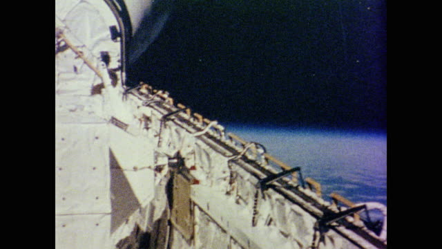 long paneled door opens on the side of space shuttle columbia before a camera pans around assessing post launch damage - 1981 stock videos & royalty-free footage