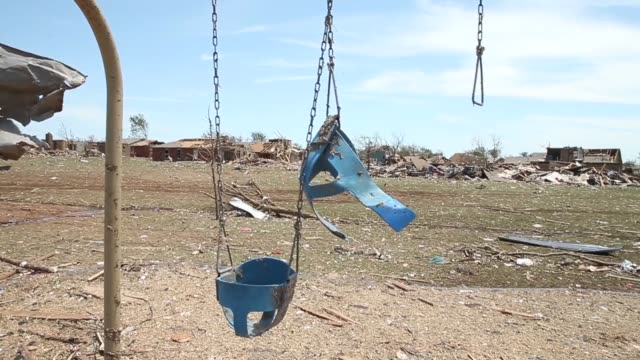 long panning shot debris litters a playground after a tornado ripped through the area on monday destroying homes and business may 22 2013 in moore... - oklahoma stock-videos und b-roll-filmmaterial