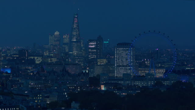 long, panning shot from buildings of the city of london to waterloo and southwark. - communication stock videos & royalty-free footage