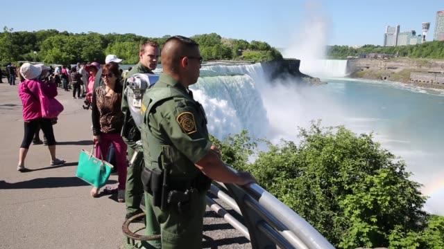 long panning shot, u.s. border patrol agents patrol next to niagara falls. border patrol monitors canadian-american border on june 03, 2013 in... - canada stock videos & royalty-free footage