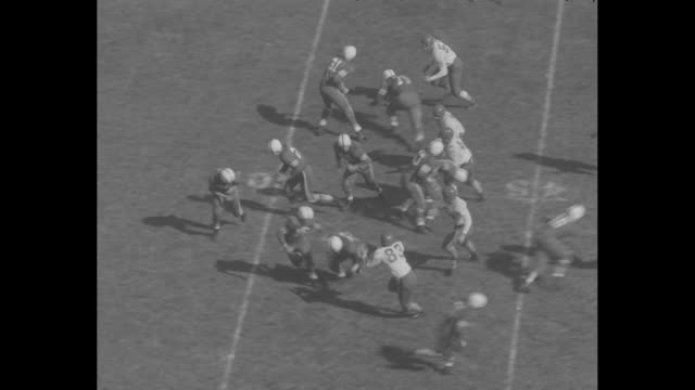 long pass by smu mustangs results in interception / three pass plays by ohio state buckeyes, last one resulting in touchdown - インターセプト点の映像素材/bロール