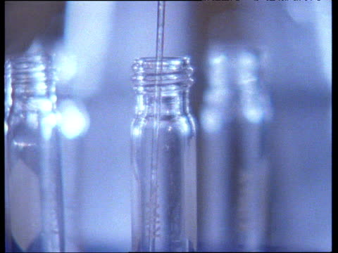 long pipette draws liquid solution from bottle - liquid solution stock videos and b-roll footage