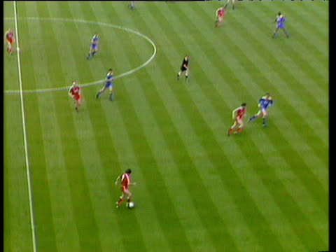 Long punt finds Ray Houghton who drives forward playing incisive one two passing with Peter Beardsley Houghton shoots from edge of box shot well...