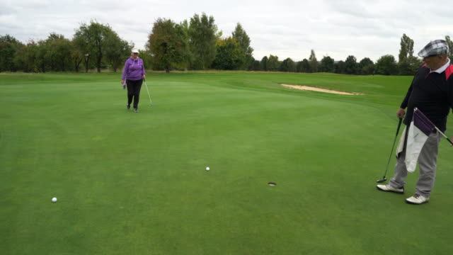 a long putt goes wide. - sun visor stock videos and b-roll footage
