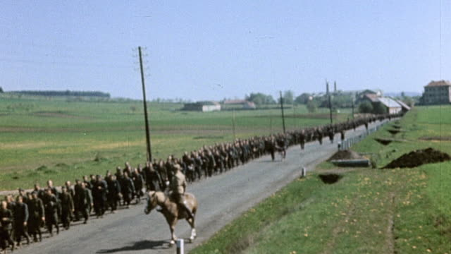 long queue of captured white russian and german army soldiers marching in street some on horseback / pilsen czech republic - ve day stock-videos und b-roll-filmmaterial