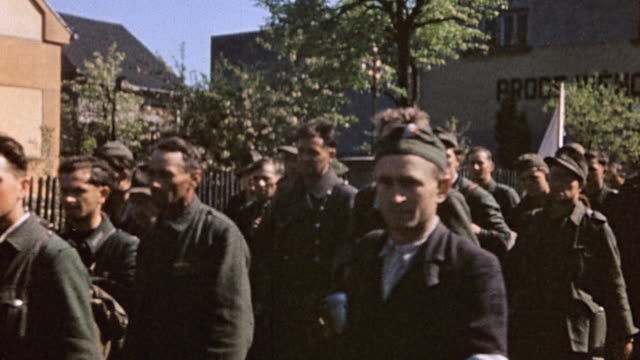long queue of captured white russian soldiers fighting for the german army marching in street, one on horseback, followed by civilians / pilsen,... - prisoner of war stock videos & royalty-free footage