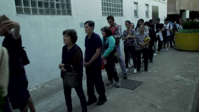 long queue of people, speeded up, waiting to vote in hong kong local elections - super slow motion stock videos & royalty-free footage
