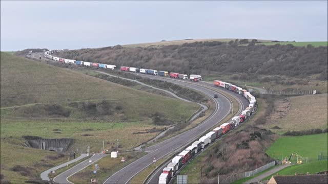 long queues of lorries snake into the port of dover on england's south coast for another day with high volumes of freight traffic and disruption at... - heavy goods vehicle stock videos & royalty-free footage