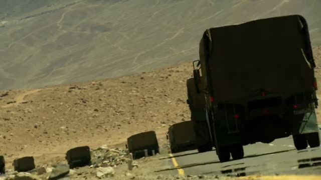 long rear shots of indian army trucks plying on the roads of ladakh - indian army stock videos & royalty-free footage