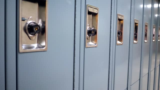 long row of lockers in high school hallway - school building stock videos & royalty-free footage