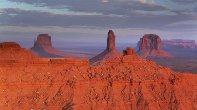long shadows at sunset in monument valley - aerial shot - monument valley stock videos & royalty-free footage