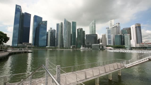 long shot a couple exit a louis vuitton store in the marina bay area of singapore on monday dec 9 commercial buildings in the central business... - fensterfront stock-videos und b-roll-filmmaterial