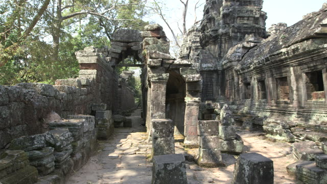 long shot across a section of the bayon temple ruins in angkor, cambodia. - cambodia stock videos and b-roll footage