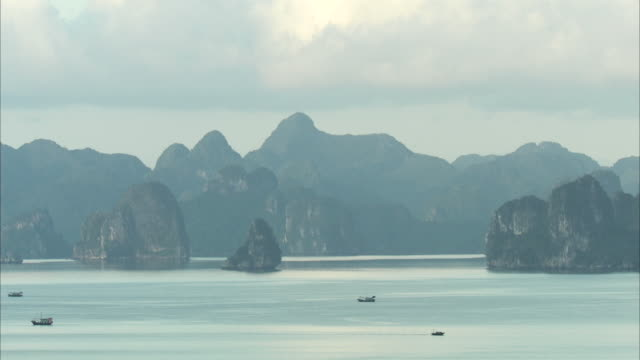 long shot across halong bay, vietnam. - pacific islands stock videos and b-roll footage