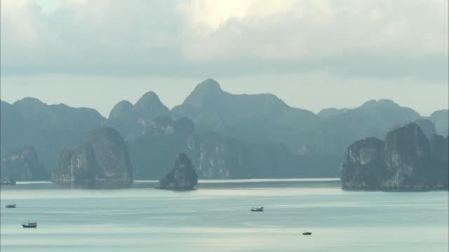long shot across halong bay, vietnam. - halong bay stock videos and b-roll footage