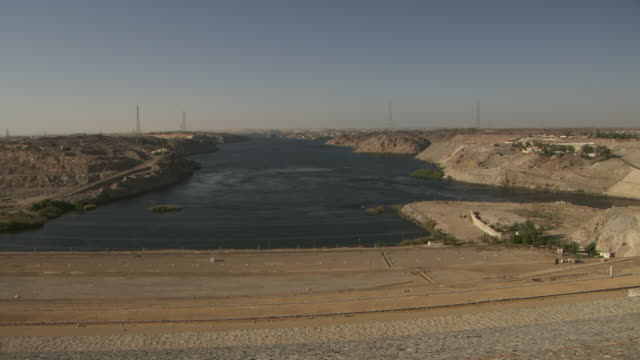 long shot across the aswan dam in egypt.  - dam stock videos & royalty-free footage