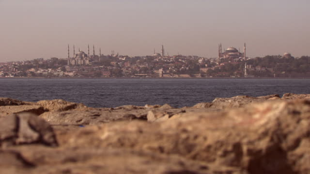 long shot across the bosphorus towards the city of istanbul. - yeni cami mosque stock videos & royalty-free footage