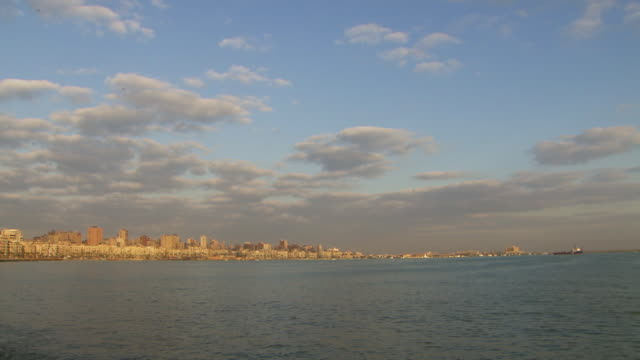 Long shot across the Nile to the waterfront area of Alexandria.