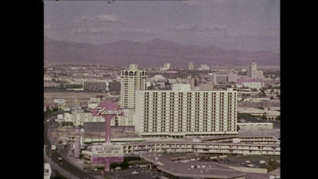 long shot across various casinos and hotels in las vegas - gambling stock videos and b-roll footage