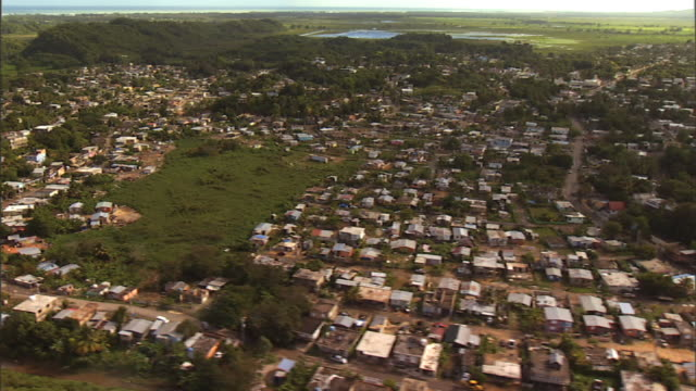 long shot aerial tracking,right , houses crowd a neighborhood in puerto rico. / puerto rico - puerto rico stock videos and b-roll footage