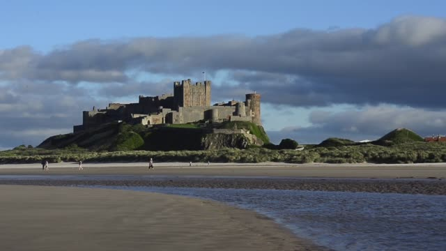 long shot bamburgh castle bamburgh castle is located on the coast at bamburgh in northumberland england built on a dolerite outcrop the location was... - northumberland coast stock videos & royalty-free footage