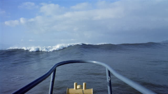 long shot boat point of view bow of ship crashing over high waves in the pacific ocean / california - ship's bow stock videos and b-roll footage