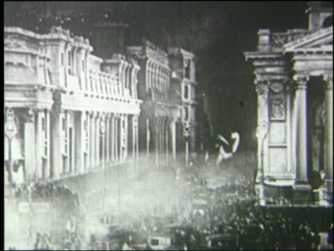 b/w 1925 long shot brontosaurus walking in crowded london street at night - 1925 stock videos & royalty-free footage
