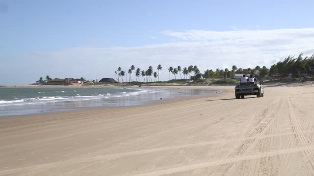Long Shot buggy driving down the beach General views from a beach in Natal Brazil shot on December 8th 2014 Natal is located on the northeastern...