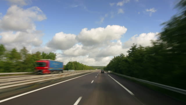 long shot car point of view driving on the a4/e 25 motorway / france - londonalight stock videos and b-roll footage