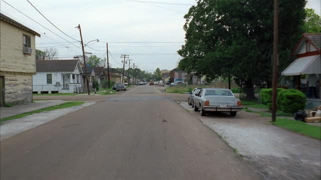 long shot car point of view traveling along small town street / louisiana - louisiana stock videos & royalty-free footage
