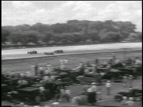 b/w 1933 long shot pan cars racing on track / indianapolis 500 - 1933 stock videos and b-roll footage