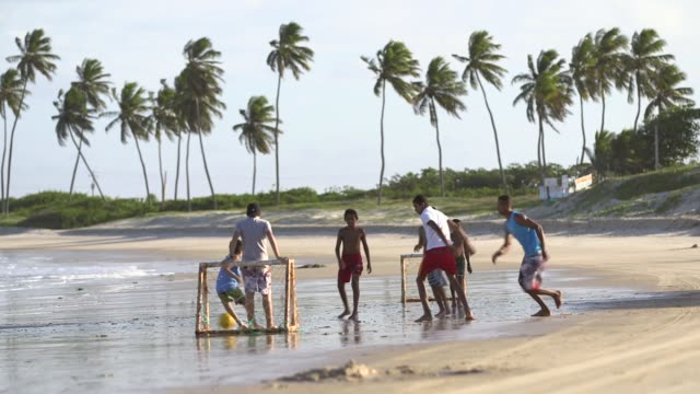 Long Shot children playing football on the beach General views from a beach in Natal Brazil shot on December 8th 2014 Natal is located on the...