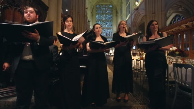 long shot choir singing catering students from the city of bath college serve more than a 100 diners sat between the choir stalls a threecourse meal... - musical instrument stock videos & royalty-free footage