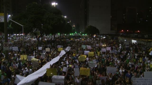 long shot crowds below double decker truck with brazil flag on avenida presidente vargas - demonstrant stock-videos und b-roll-filmmaterial