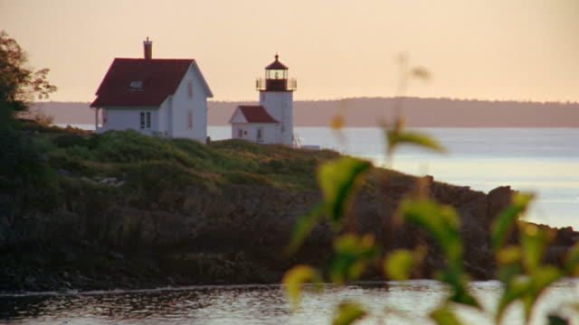 long shot curtis island lighthouse at twilight / camden harbor, maine - sequential series stock videos & royalty-free footage