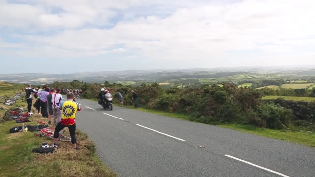 long shot cyclists of the tour of britain passing cheering fans stage six of the tour of britain made history this year as it was the first stage to... - tour of britain stock videos & royalty-free footage