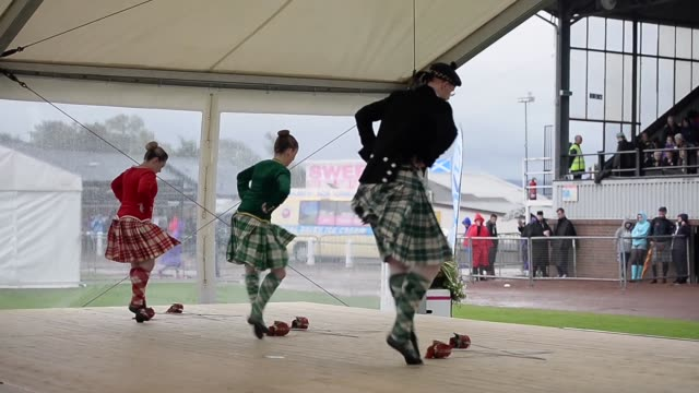 long shot dancer competing at the cowal highland gathering people attend the cowal highland gathering on august 30 2013 in dunoon scotland first held... - highland games stock videos & royalty-free footage