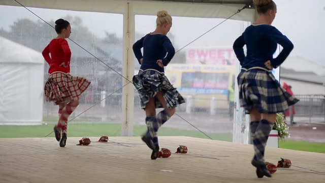 long shot dancers competing at the cowal highland gathering people attend the cowal highland gathering on august 30 2013 in dunoon scotland first... - highland games stock videos & royalty-free footage