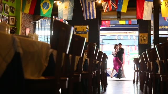 Long Shot Dancers perform a Tango at La Boca on September 11 2013 in Buenos Aires Argentina