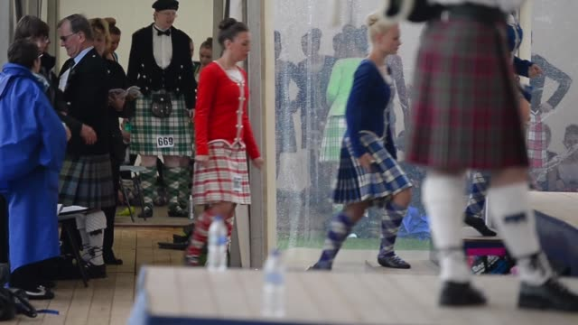 long shot dancers warming up before they walk on the stage people attend the cowal highland gathering on august 30 2013 in dunoon scotland first held... - highland games stock videos & royalty-free footage