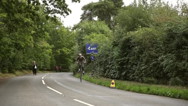 long shot david preece riding his penny farthing bike up towards the stage finish stage six of the tour of britain made history this year as it was... - tour of britain stock videos & royalty-free footage