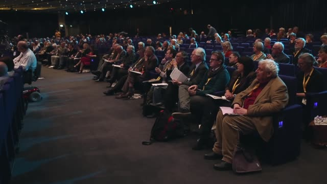 long shot delegates listening to a speech at the libdem conference in glasgow the liberal democrat autumn conference began in glasgow on the 13th of... - conference centre stock videos & royalty-free footage